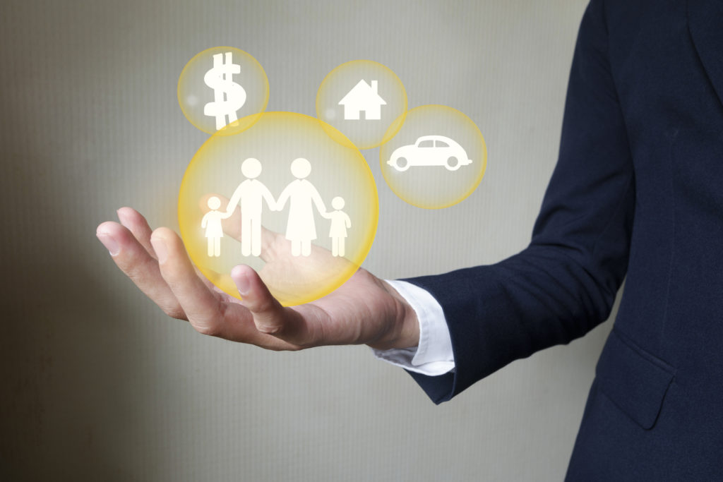 Businessman holding protect family , insurance concept