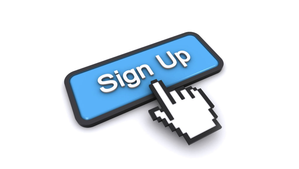 Sign up on a blue box with a black outline with a hand nearly clicking the button
