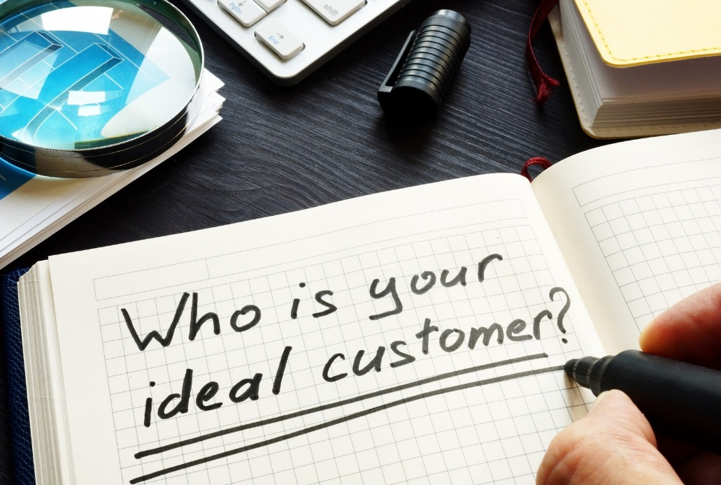 Who is your ideal customer written in black ink in a notepad