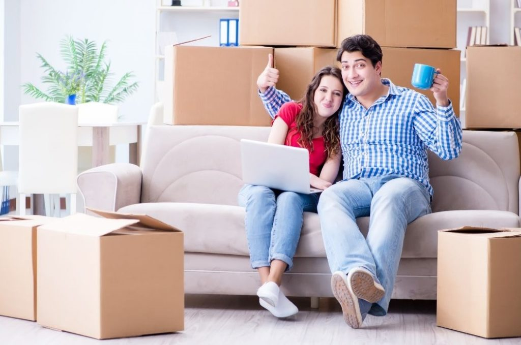 Couple sitting on the sofa after moving into a new house