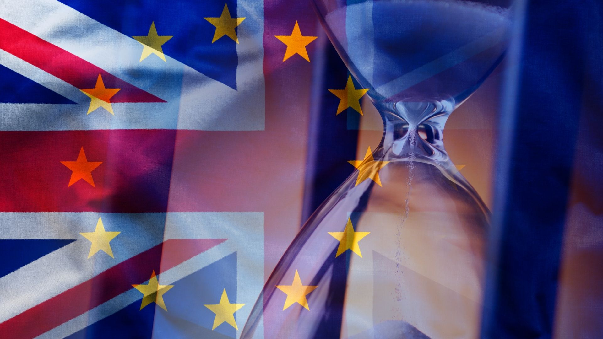 Image of a sand timer with the GB and Eu flag in the background