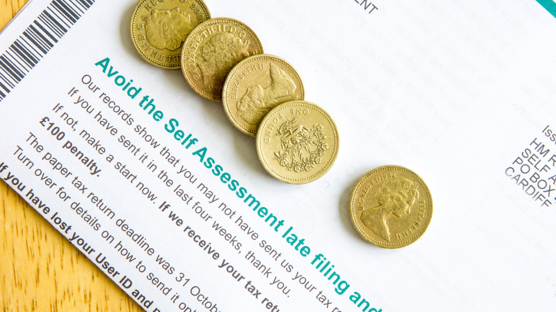 image of some pound coins on tops of a tax return form