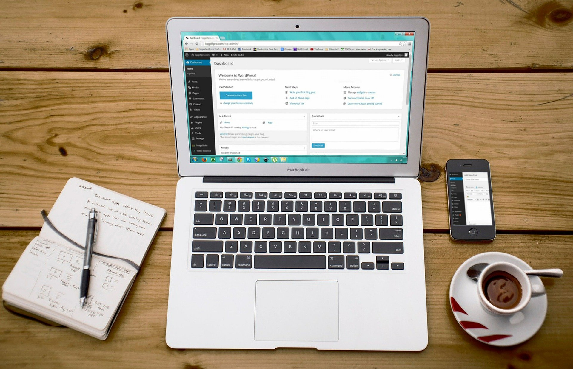 image of a laptop on a desk with the wordpress dashboard open